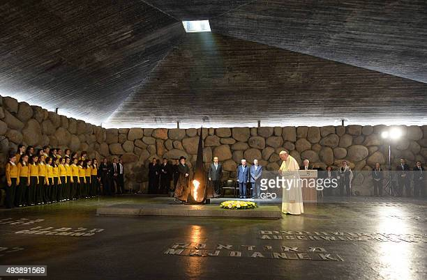 In this handout provided by the Israeli Government Press Office Pope Francis visits the Yad Vashem Holocaust Museum with Israeli President Shimon...