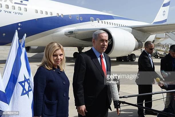 In this handout provided by the Israeli Government Press Office, Prime Minister Benjamin Netanyahu and his wife Sarah leave Tel Aviv on their way to...
