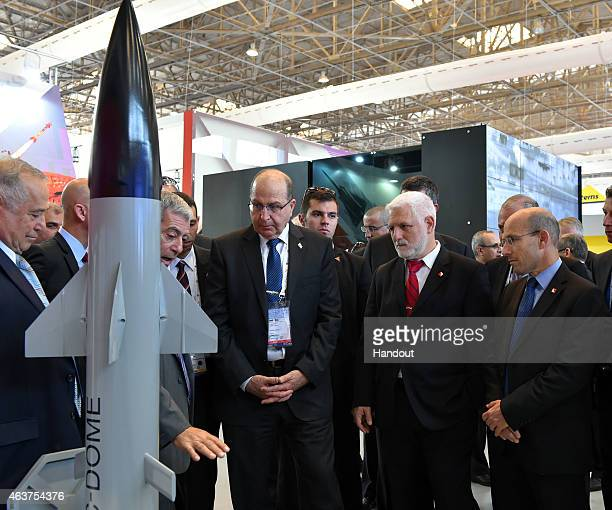 In this handout provided by the Israeli Ministry of Defence Israeli Defense Minister Moshe Ya'alon visits the arms exhibition in India at Aero India...