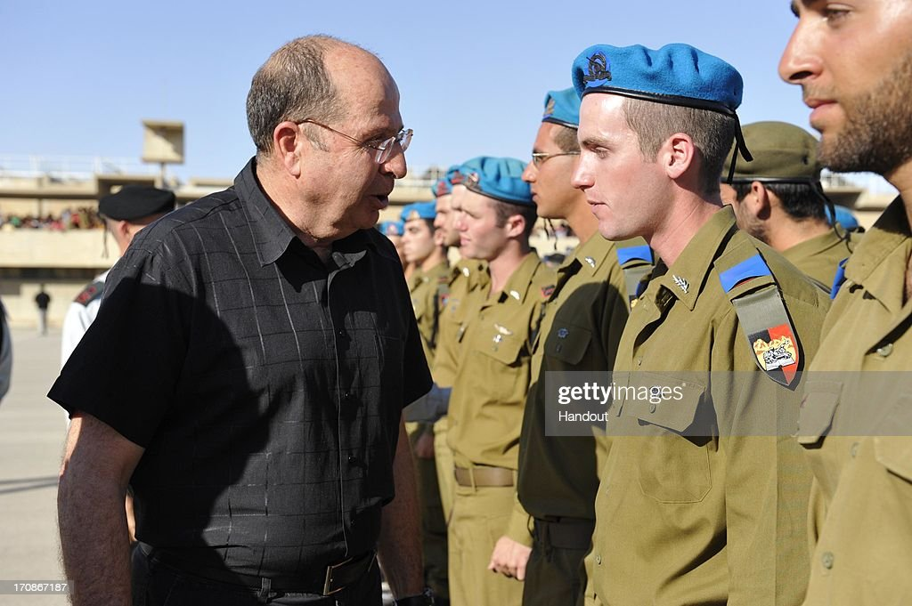 In this handout provided by the Israeli Ministry of Defense, Defense Minister Moshe Ya'alon attends an officers' graduation ceremony at Training Base 1, June 19, 2013 in Mitzpe Ramon, Israel. During the ceremony Ya'alon called on the international community to stop Iran from obtaining nuclear weapons.
