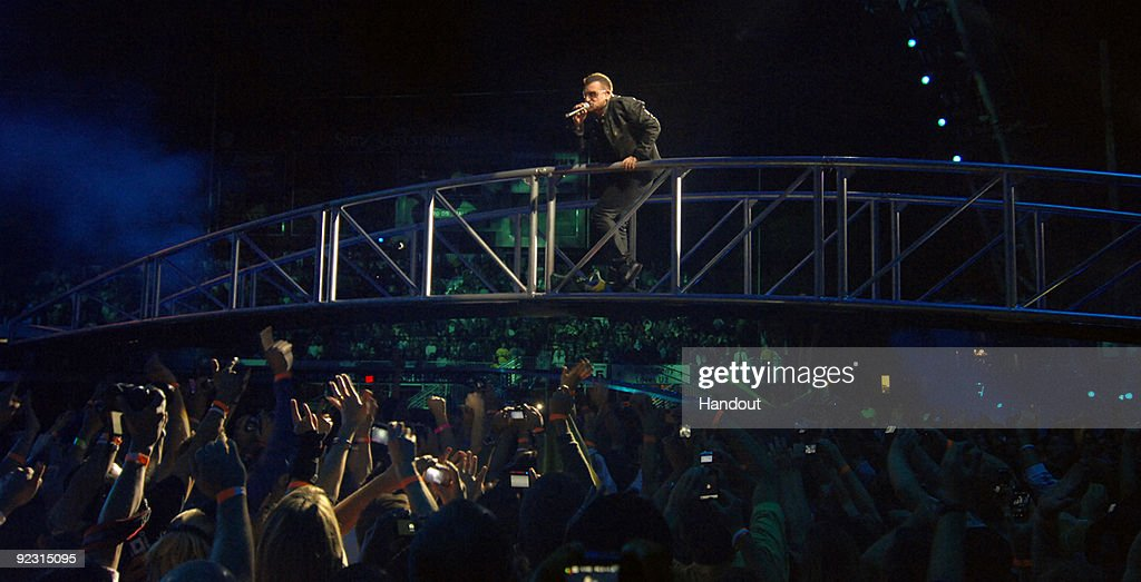 In this handout provided by the Las Vegas News Bureau, Bono of U2 performs at Sam Boyd Stadium on October 23, 2009 in Las Vegas, Nevada.