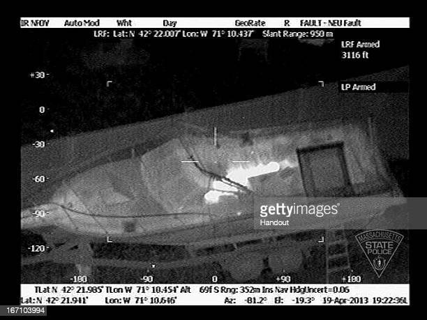 In this handout provided by the Massachusetts State Police the boat in which Boston Marathon bombing suspect Dzhokhar A Tsarnaev is hiding is seen...