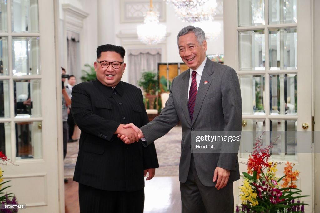 In this handout provided by the Ministry of Communications and Information of Singapore shows North Korean leader Kim Jong-un (L) with Singapore's Prime Minister Lee Hsien Loong (R) on June 10, 2018 in Singapore, Singapore. The historic meeting between U.S. President Donald Trump and North Korean leader Kim Jong-un has been scheduled in Singapore for June 12 as the world awaits for the landmark summit in the Southeast Asian city-state.