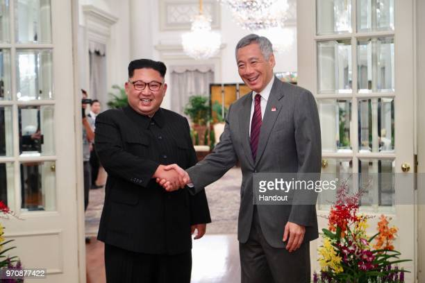In this handout provided by the Ministry of Communications and Information of Singapore shows North Korean leader Kim Jongun with Singapore's Prime...