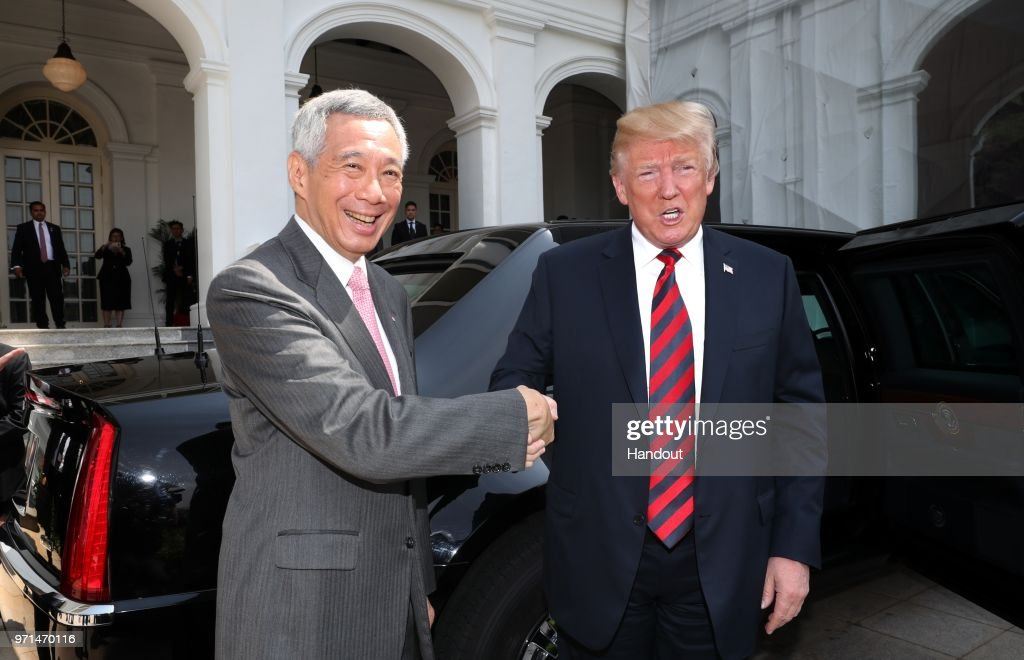In this handout provided by the Ministry of Communications and Information of Singapore, U.S. President Donald Trump (R) with Singapore's Prime Minister Lee Hsien Loong (L) on June 11, 2018 in Singapore, Singapore. The historic meeting between U.S. President Donald Trump and North Korean leader Kim Jong-un has been scheduled in Singapore for June 12 as the world awaits for the landmark summit in the Southeast Asian city-state.