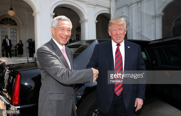 In this handout provided by the Ministry of Communications and Information of Singapore US President Donald Trump with Singapore's Prime Minister Lee...