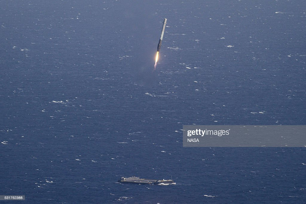 In this handout provided by the National Aeronautics and Space Administration (NASA), SpaceX's Falcon 9 rocket makes its first successful upright landing on the 'Of Course I Still Love You' droneship on April 8, 2016 some 200 miles off shore in the Atlantic Ocean after launching from Cape Canaveral, Florida.