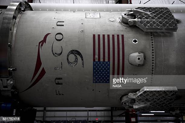 In this handout provided by the National Aeronautics and Space Administration SpaceX's Falcon 9 first stage rocket waits in a hangar on December 29...