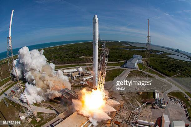 In this handout provided by the National Aeronautics and Space Administration , SpaceXs Falcon 9 rocket and Dragon spacecraft lift off from Launch...