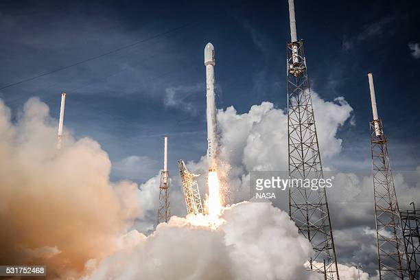 In this handout provided by the National Aeronautics and Space Administration SpaceX's Falcon 9 rocket launches the ORBCOMM OG2 Mission 1 on July 14...