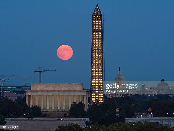 In this handout provided by the National Aeronautics and Space Administration a full moon or Harvest Moon rises over government landmarks Lincoln...