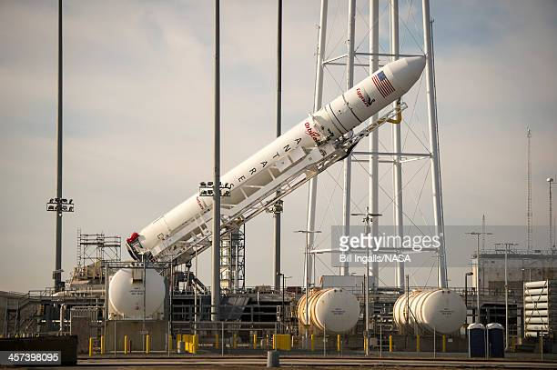 In this handout provided by the National Aeronautics and Space Administration an Orbital Science Corporation Antares rocket raised into position at...