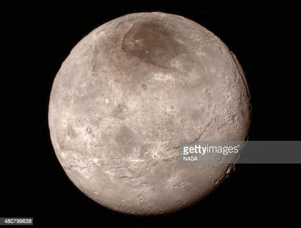 In this handout provided by the National Aeronautics and Space Administration , Pluto's largest moon Charon is shown from a distance of 289,000 miles...