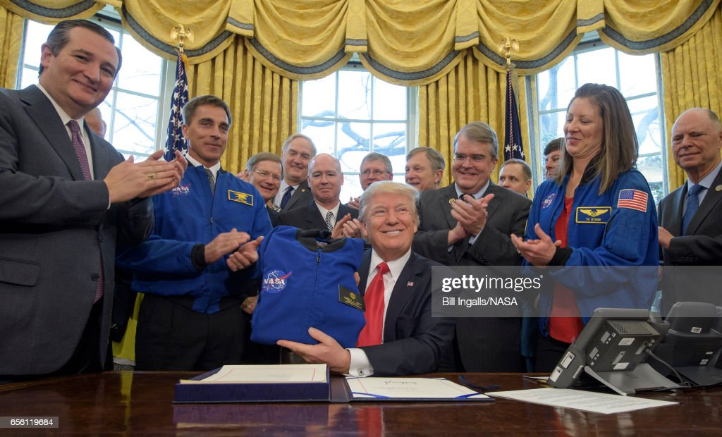 President Trump Signs Bill To Increase Funding To NASA : News Photo