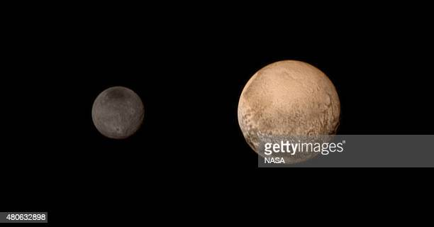 In this handout provided by the National Aeronautics and Space Administration the dwarf planet Pluto and Charon are shown July 11 2015 NASA's New...