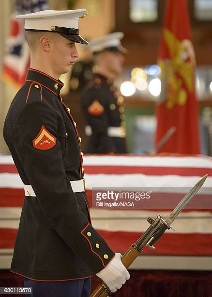 In this handout provided by the National Aeronautics and Space Administration The United States Marine honor guard performs a Changing of the Guard...