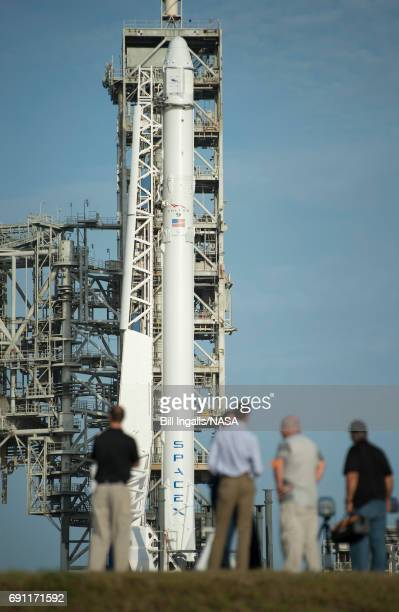 In this handout provided by the National Aeronautics and Space Administration , the SpaceX Falcon 9 rocket, with the Dragon spacecraft onboard, is...