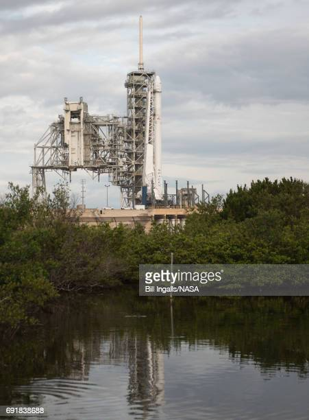 In this handout provided by the National Aeronautics and Space Administration the SpaceX Falcon 9 rocket with the Dragon spacecraft onboard is seen...