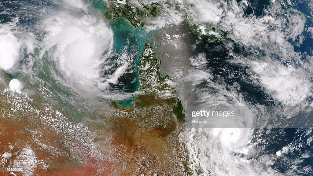 In this handout provided by the National Oceanic and Atmospheric Administration (NOAA), Cyclone Lam in the Arafura Sea and Cyclone Marcia off the east coast of Queensland are both expected to make landfall on February 19, 2015 in Australia. This image is a combination of two passes from the Suomi NPP satellite's VIIRS instrument taken around 0345Z to the east and 0530Z to the west. Cyclone Marcia was expected to be a Category 5 storm.