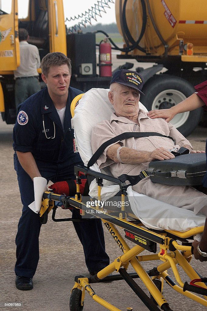 In this handout provided by the Navy Visual News Service, U.S. Navy Hospital Corpsman 3rd Class Michael Riley, assigned to Naval Air Station (NAS) Jacksonville Branch Medical Center, transports retired Army World War II and Korean War Veteran Hugh Cooper, 86, to Naval Hospital Jacksonville on August 31, 2005 in Jacksonville, Florida. Cooper, a resident of Gulfport, Miss., was medically evacuated from the area after Hurricane Katrina devastated the Gulf Coast.