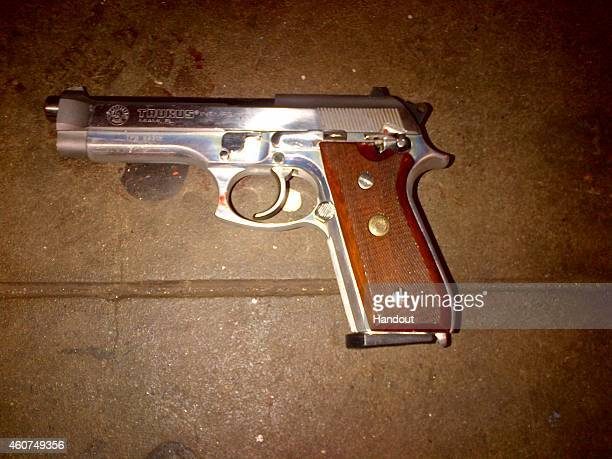 In this handout provided by the New York Police Department a silver semiautomatic Taurus firearm that was recovered on the platform of the Myrtle...