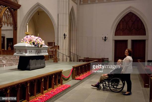 In this handout provided by the Office of George HW Bush former President George H W Bush looks at the casket with his daughter Dorothy Doro Bush...