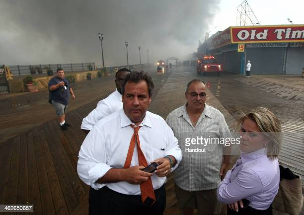 In this handout provided by the Office of the Governor Of NJ Governor Chris Christie tours the fire area with Deputy Chief of Staff Bridget Anne...
