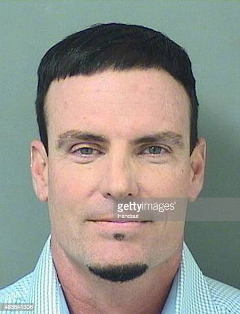 In this handout provided by the Palm Beach County Jail Rapper Vanilla Ice also known as Robert Van Winkle poses for his mugshot after being arrested...