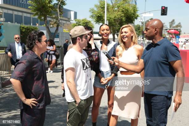 In this handout provided by the Paramount Pictures Jon Bass Zac Efron Alexandra Daddario Ilfenesh Hadera and Kelly Rohrbach are interviewed by Kevin...