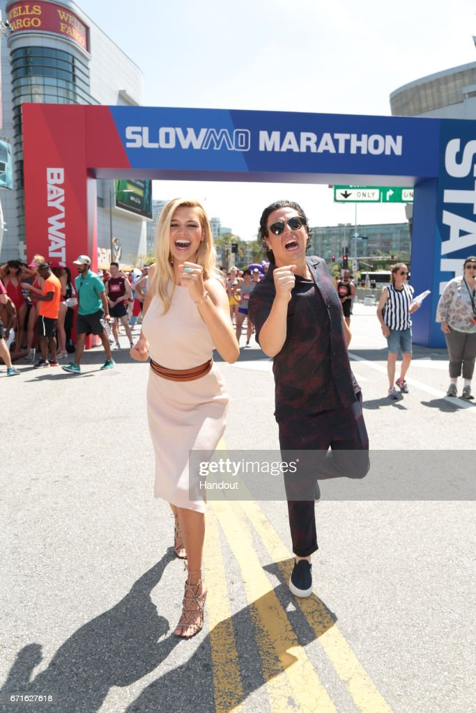 In this handout provided by the Paramount Pictures,Kelly Rohrbach and Jon Bass pose as Paramount Pictures presents the first ever Baywatch SloMo Marathon at Microsoft Square on April 22, 2017 in Los Angeles, California.