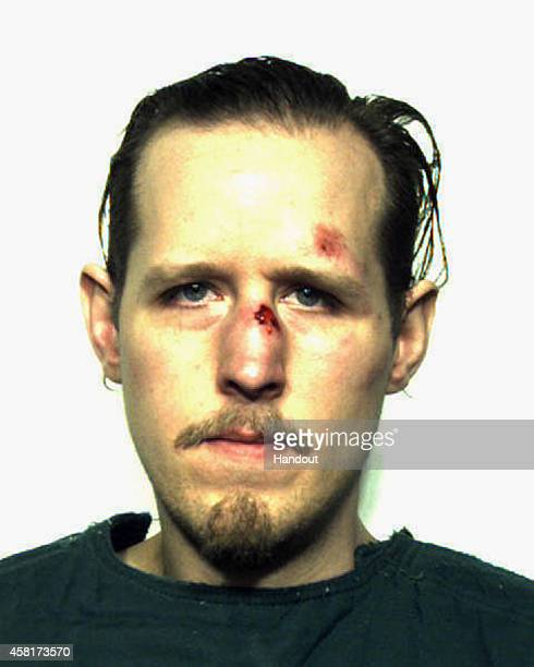 In this handout provided by the Pike County Correctional Facility Eric Frein poses for a mug shot after being captured by authorities on October 30...