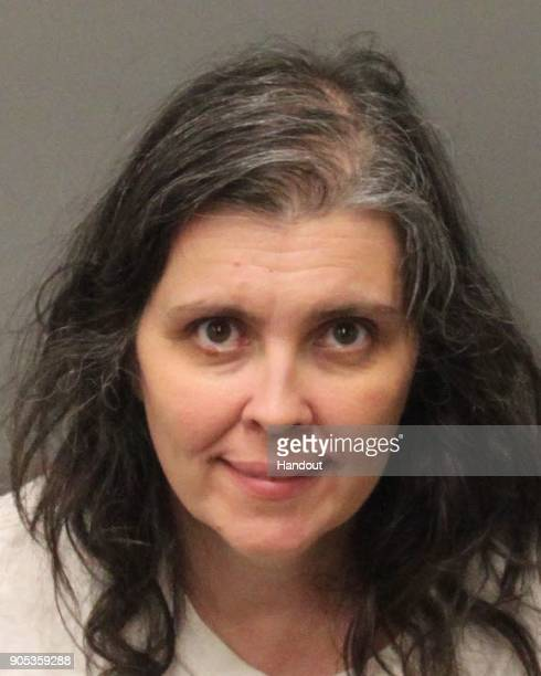 In this handout provided by the Riverside County Sheriffs Department Louise Anna Turpin poses for a mugshot after being arrested when 13 siblings...