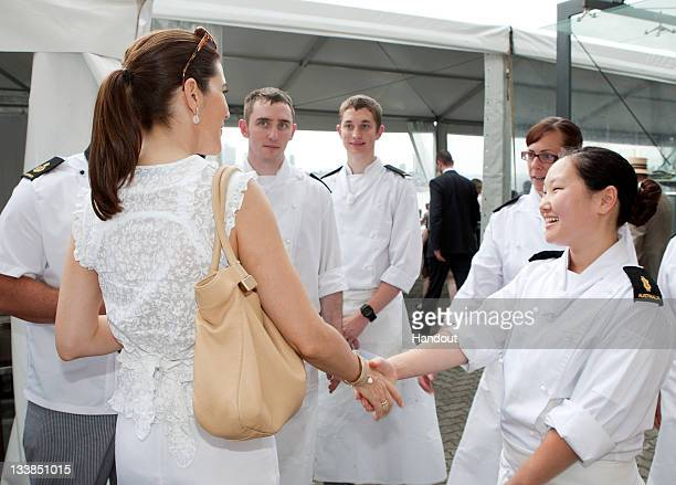 In this handout provided by the Royal Australian Navy Able Seaman Cook Kate Svanselds shakes hands with Princess Mary of Denmark during a visit to...