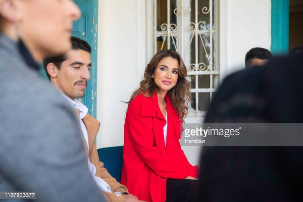 In this handout provided by the Royal Hashemite Court, Jordan's Queen Rania tours the Jabal Al-Luweibdeh neighbourhood on April 17 in Amman, Jordan....