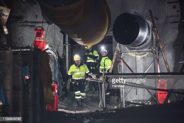 In this handout provided by the Stand With Pike Families Reference Group, workers reopen the entrance to the Pike River Mine on May 21, 2019 in...