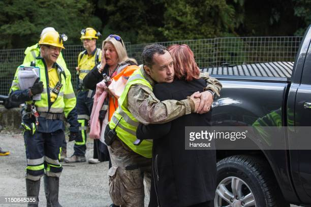 In this handout provided by the Stand With Pike Families Reference Group family members and workers hug before reentry at the Pike River Mine on May...
