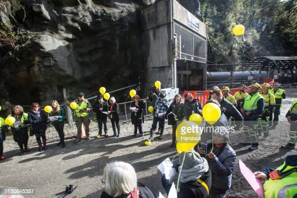 In this handout provided by the Stand With Pike Families Reference Group, family members release balloons before re-entry at the Pike River Mine on...