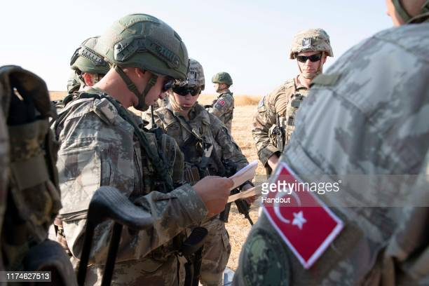 In this handout provided by the US Army US and Turkish military forces conduct the third ground combined joint patrol inside the security mechanism...