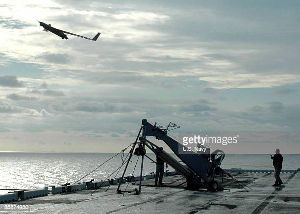 In this handout provided by the US Navy a Scan Eagle unmanned aerial vehicle launches from the flight deck of the amphibious assault ship USS Saipan...