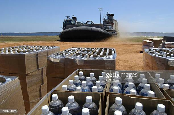In this handout provided by the US Navy A US Navy Landing Craft comes ashore on Barrancas Beach aboard Naval Air Station Pensacola Fla to pick up...