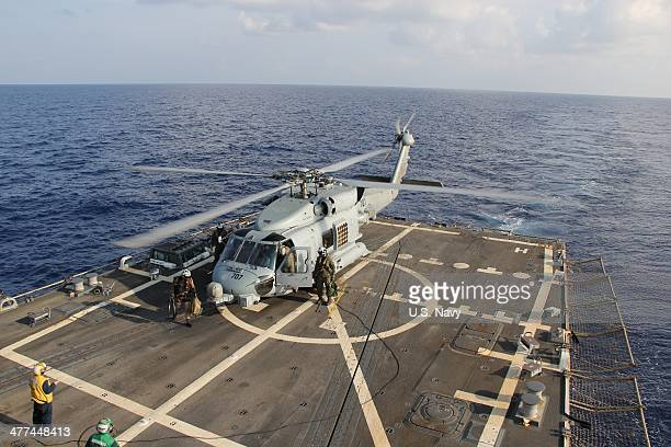 In this handout provided by the US Navy a US Navy MH60R Sea Hawk helicopter from Helicopter Maritime Strike Squadron 78 Det 2 assigned to the...