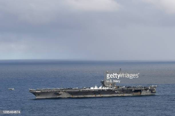 In this handout provided by the US Navy an F/A18 Super Hornet assigned to Carrier Air Wing 1 launches from the Nimitzclass aircraft carrier USS Harry...