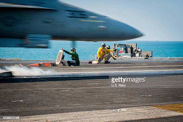 In this handout provided by the US NAVY An F/A18C Hornet from the Stingers of Strike Fighter Squadron 113 launches Thursday Nov 27 2014 from the...