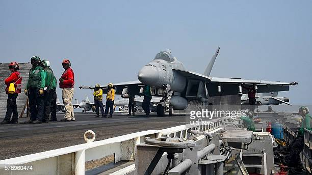 In this handout provided by the U.S. Navy, An F/A-18E Super Hornet assigned to the Sidewinders of Strike Fighter Squadron 86 prepares to launch from...