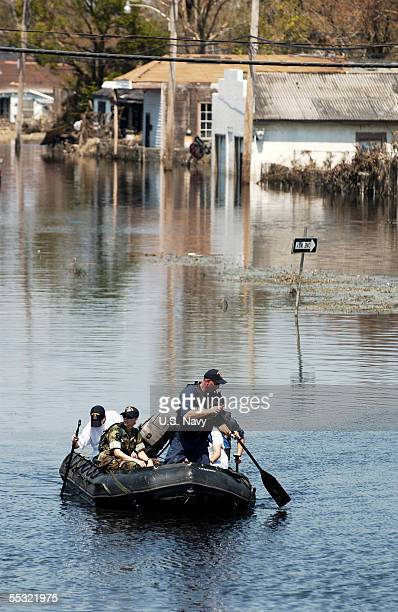 In this handout provided by the US Navy Navy Sailors search flooded New Orleans neighbourhoods for survivors of Hurricane Katrina on September 6 2005...