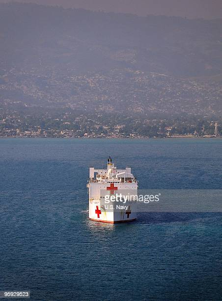 In this handout provided by the US Navy the Military Sealift Command hospital ship USNS Comfort is seen January 20 2010 off the coast of Haiti...