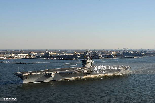 In this handout provided by the US Navy the Nimitzclass aircraft carrier USS Dwight D Eisenhower pulls away from the pier February 21 2013 at Naval...