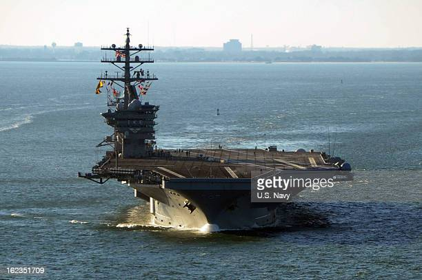 In this handout provided by the U.S. Navy, the Nimitz-class aircraft carrier USS Dwight D. Eisenhower departs Naval Station Norfolk for a deployment...