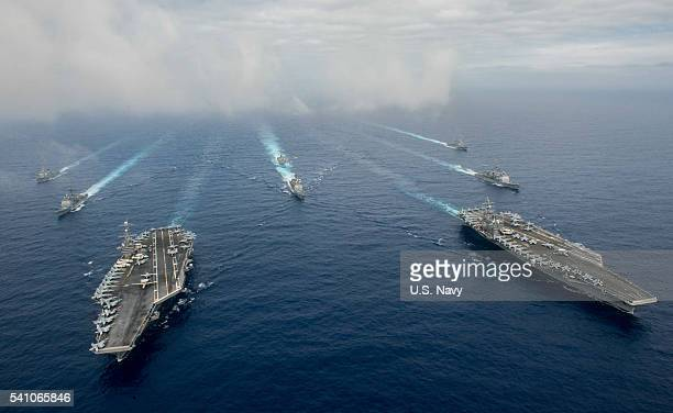 In this handout provided by the US Navy The Nimitzclass aircraft carriers USS John C Stennis and USS Ronald Reagan conduct dual aircraft carrier...