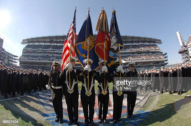 In this handout provided by the U.S. Navy, the U.S. Naval Academy Color Guard presents the colors during march-on ceremonies during the 106th playing...